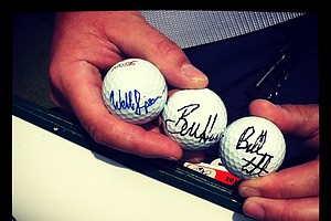 Standard bearer, Jim Ayotte, shows off signed golf balls from Webb Simpson, Bubba Watson and Bill Haas in Round 2 of the Arnold Palmer Invitational.