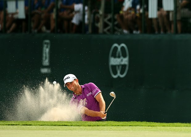 Luke Guthrie hits out of the bunker at No. 17 on Saturday.