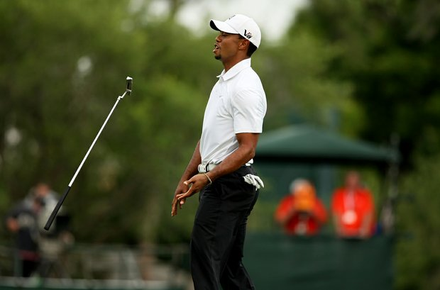 Tiger Woods reacts to just missing a birdie putt at No. 17.