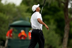 Tiger Woods reacts to missing his putt at No. 17.