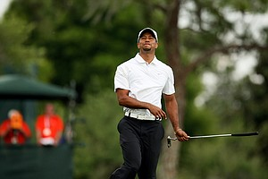 Tiger Woods reacts to missing his birdie putt at  no.17.