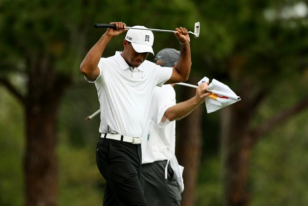Tiger Woods reacts to missing his birdie putt at No. 17.