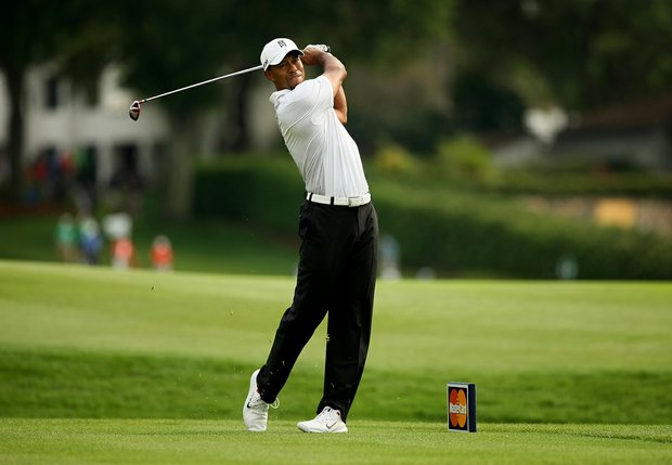 Tiger Woods tees off at No. 18 on Saturday at Arnold Palmer Invitational. He has the lead by two shots over Rickie Fowler.