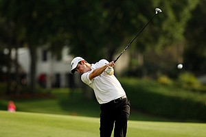 Justin Rose hits his tee shot at No. 18 on Saturday. Rose fell out of the lead by shooting a 72 on Saturday.