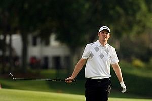 Justin Rose hits his tee shot at No. 18 on Saturday. Rose is two shots behind Tiger Woods heading into the final round.