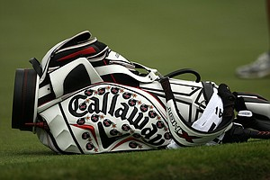 Chris Kirk's bag lays beside the eighth green at Bay Hill, covered with Callaway Xbomb patches.