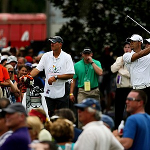 Tiger Woods watches his tee shot on the second hole at Bay Hill.