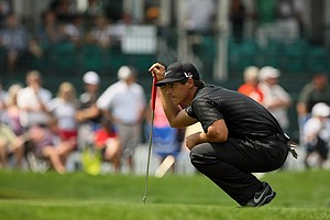 Thorbjorn Olesen looks over his putt at No. 8 on Saturday.