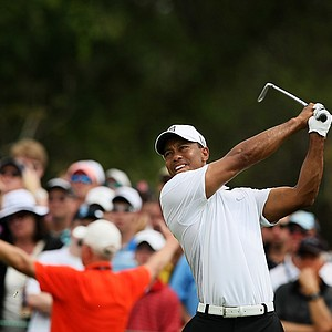 Tiger Woods hits his tee shot at No. 7 on Saturday at the Arnold Palmer Invitational.