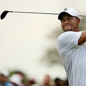 Tiger Woods hits his tee shot at No. 8 on Saturday at the Arnold Palmer Invitational.