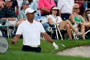 Tiger Woods reacts to a bunker shot near Bay Hill's eighth green.