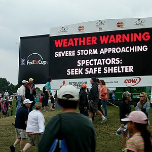 Digital scoreboards warn spectators to take cover for severe weather during the final round at Arnold Palmer Invitational at Bay Hill. Play was canceled for the day and will resume at 10 a.m. on Monday.