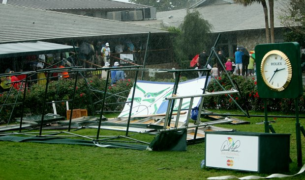 The scoreboard lies mangled behind the 10th tee box in the final round at Arnold Palmer Invitational at Bay Hill. Play has been suspended until Monday at 10 a.m.