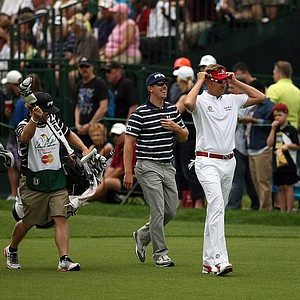 Ian Poulter and Hunter Mahan leave the first tee in the final round at Arnold Palmer Invitational at Bay Hill. They made it through 6 holes before play was called.