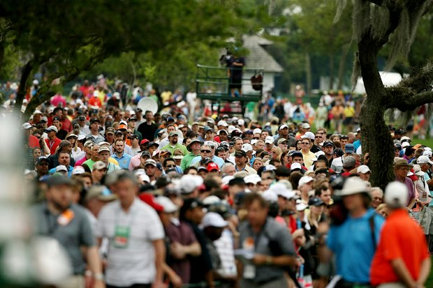 Spectators line the fairway at No. 1 trying to catch a glimpse of Tiger Woods and Rickie Fowler in the final round at Arnold Palmer Invitational at Bay Hill.