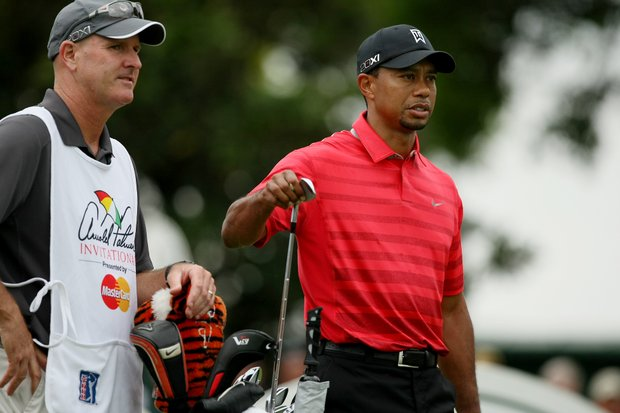 Tiger Woods with hs caddie Joe Lacava at No. 2 in the final round at Arnold Palmer Invitational at Bay Hill.