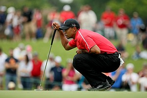 Tiger Woods looks over his putt at No. 2 in the final round at Arnold Palmer Invitational at Bay Hill.