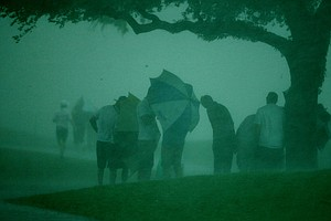 Spectators take cover as storms rip through the final round at Arnold Palmer Invitational at Bay Hill.