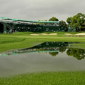 Large puddles of water flood the fairway at No. 18 after severe weather ripped through during the final round at Arnold Palmer Invitational at Bay Hill. Play will resume on Monday at 10 a.m.