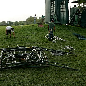 Crews pile parts of a TV tower at No. 10 green after a severe storm came through in the final round at Arnold Palmer Invitational at Bay Hill.