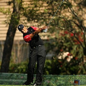 Tiger Woods hits his tee shot at No. 8 on Monday at Arnold Palmer Invitational at Bay Hill.