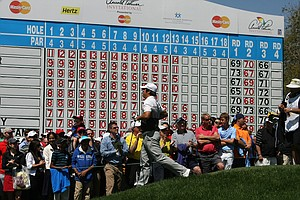 John Huh runs past the leaderboard at No. 15 on Monday at Arnold Palmer Invitational at Bay Hill.