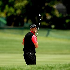 Tiger Woods watches his bunker shot at No. 16 on Monday at Arnold Palmer Invitational at Bay Hill.