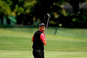 Tiger Woods watches his bunker shot at No. 16 on Monday at Arnold Palmer Invitational at Bay Hill.