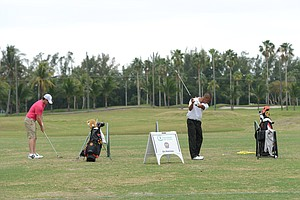 Rory Mcilroy practices on Miami Municipal Golf Course on Friday.