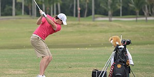 PHOTOS: McIlroy hits on the range at Miami Muni