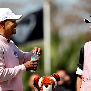Tiger Woods with his caddie Joe LaCava during the 2013 Tavistock Cup at Isleworth Country Club.