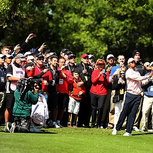 Tiger Woods hits his second shot at No. 1 during the 2013 Tavistock Cup at Isleworth Country Club.