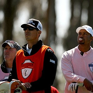 Tiger Woods, representing Team Albany, blows a bubble with his gum while waiting on the tee box at No. 3 in the during the 2013 Tavistock Cup at Isleworth Country Club.