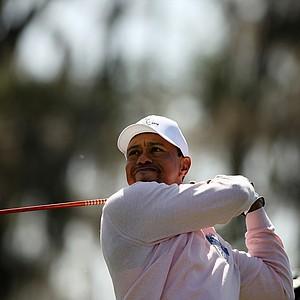 Tiger Woods hits his tee shot at No. 3 during the 2013 Tavistock Cup at Isleworth Country Club.