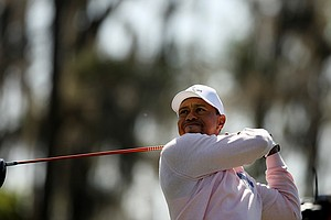 Tiger Woods hits his tee shot at No. 3 during the 2013 Tavistock Cup at Isleworth Country Club.