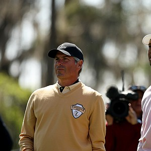 Fred Couples and Tiger Woods watch Woods' tee shot at No. 3 during the 2013 Tavistock Cup at Isleworth Country Club.