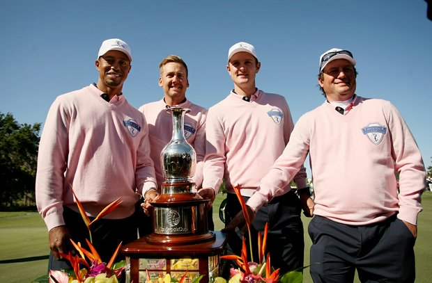 Team Albany wins the cup during the 2013 Tavistock Cup at Isleworth Country Club. From left, Tiger Woods, Ian Poulter, Justin Rose and Tim Clark.