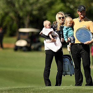 Webb Simpson with his family after he was awarded the Payne Stewart Salver Award during the 2013 Tavistock Cup at Isleworth Country Club.