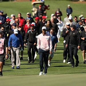 Tiger Woods walks up to the 18th during the 2013 Tavistock Cup at Isleworth Country Club.