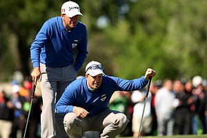 Henrik Stenson and Graeme McDowell at No. 18 during a playoff in the 2013 Tavistock Cup at Isleworth Country Club.