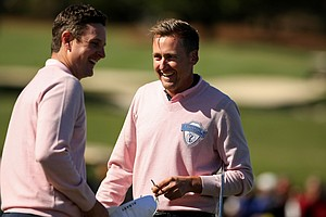 Ian Poulter and Justin Rose celebrate Poulter's putt in a playoff during the 2013 Tavistock Cup at Isleworth Country Club.