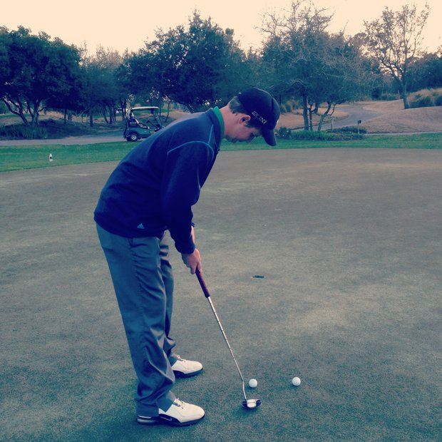 Myers Park High School player Davis Morrison uses an anchored putter.