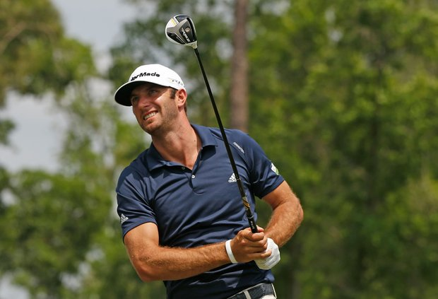 Dustin Johnson watches his tee shot on the 11th hole during the final round of the Shell Houston Open.