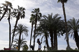 Michelle Wie watches her tee shot on the 14th hole during the first round of the LPGA Kraft Nabisco Championship.