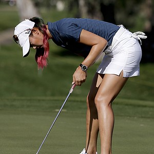 Michelle Wie makes a putt on the 12th green during the first round of the LPGA Kraft Nabisco Championship.
