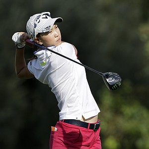 Momoko Ueda, of Japan, watches her shot on the third hole during the first round of the LPGA Kraft Nabisco Championship.