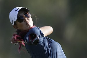 Michelle Wie watches her tee shot on the 11th hole during the first round of the LPGA Kraft Nabisco Championship.
