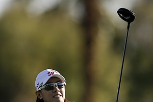 Na Yeon Choi, of South Korea, watches her tee shot on the 11th hole during the first round of the LPGA Kraft Nabisco Championship.
