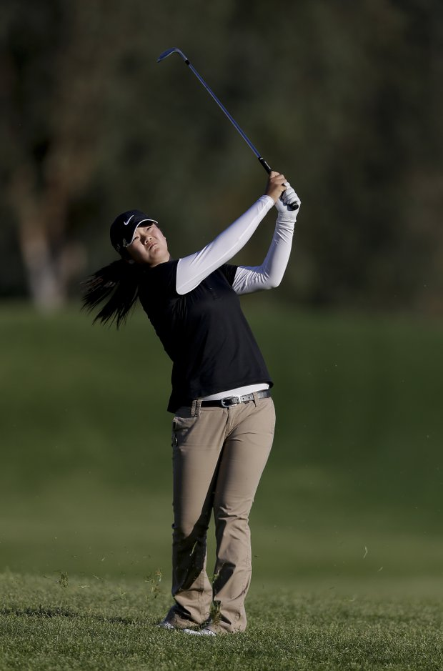 Angel Yin hits from the rough on the second hole during the first round of the LPGA Kraft Nabisco Championship.
