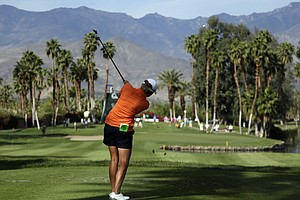 Stacy Lewis hits from the tee on the 14th hole during the first round of the LPGA Kraft Nabisco Championship.